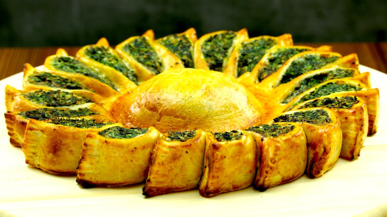 Vegetarische Sonne aus Spinat, Ricotta und Parmesan nach dem Backen